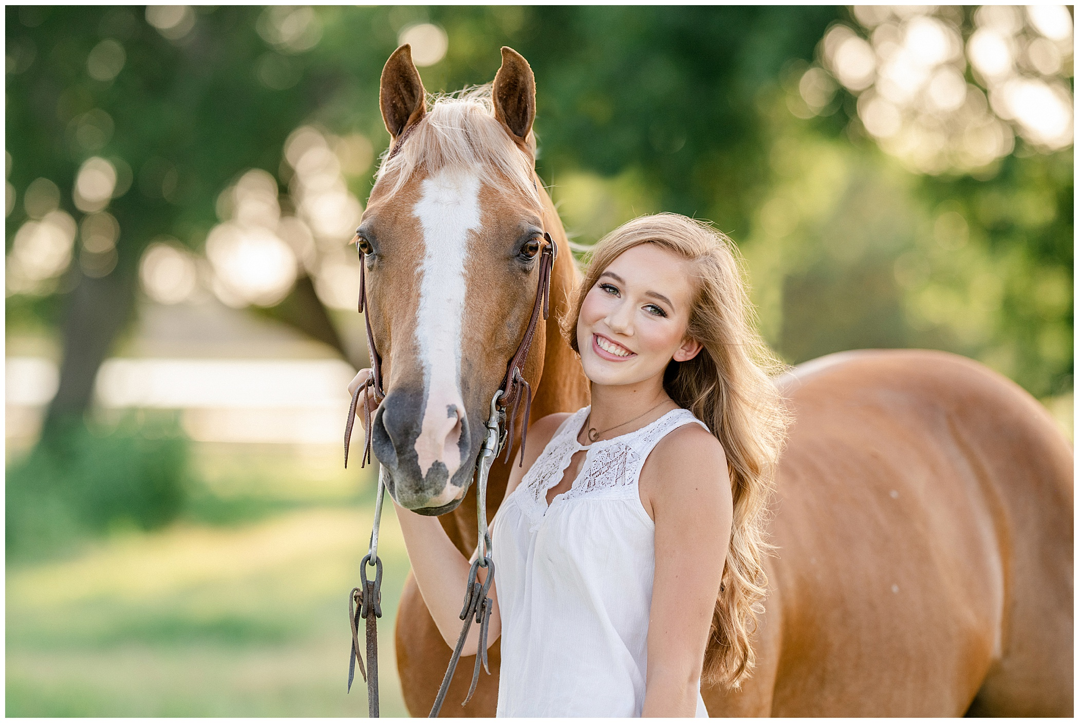 Young blonde girl with palomino horse in a field