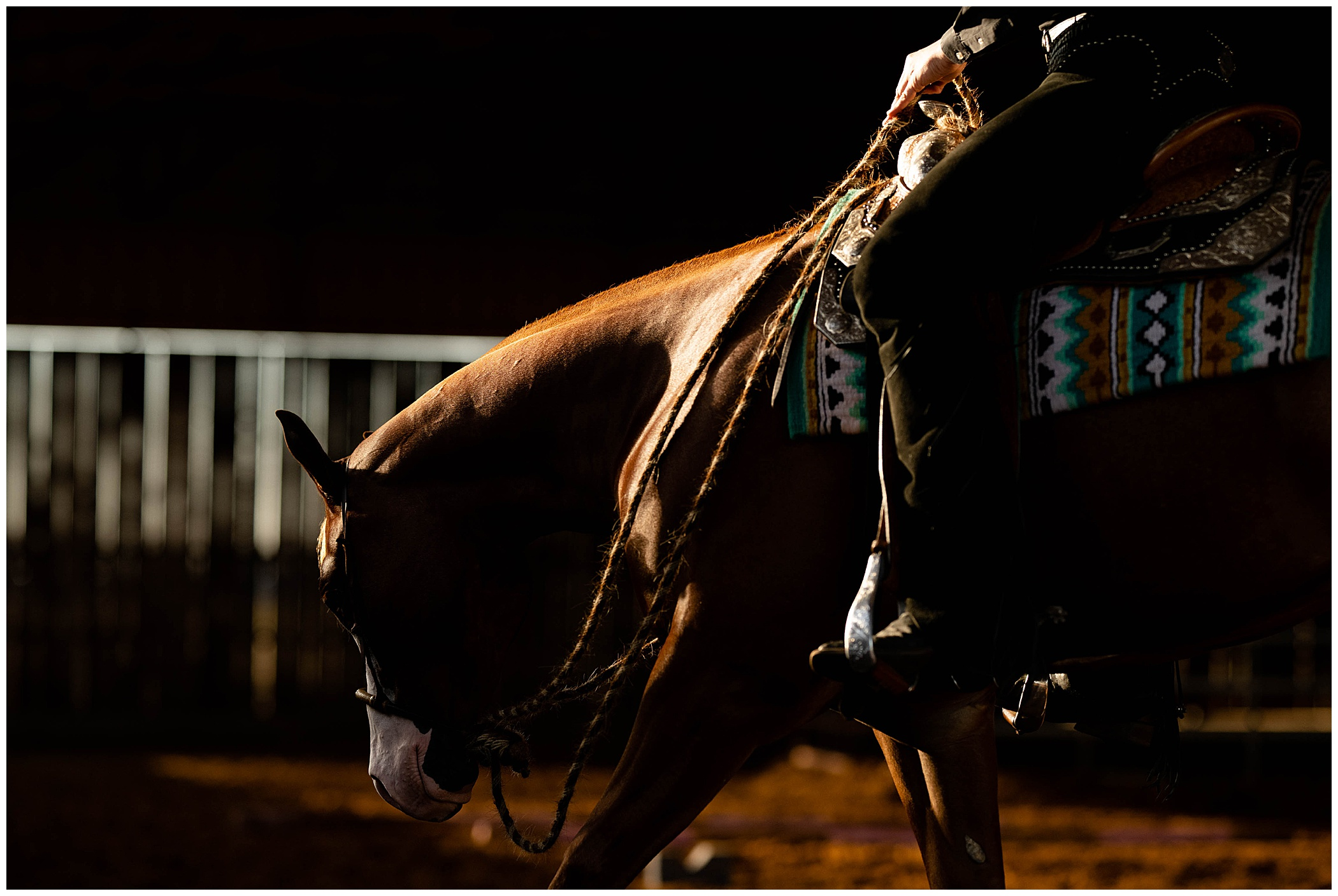 Person riding a western horse with dramatic lighting