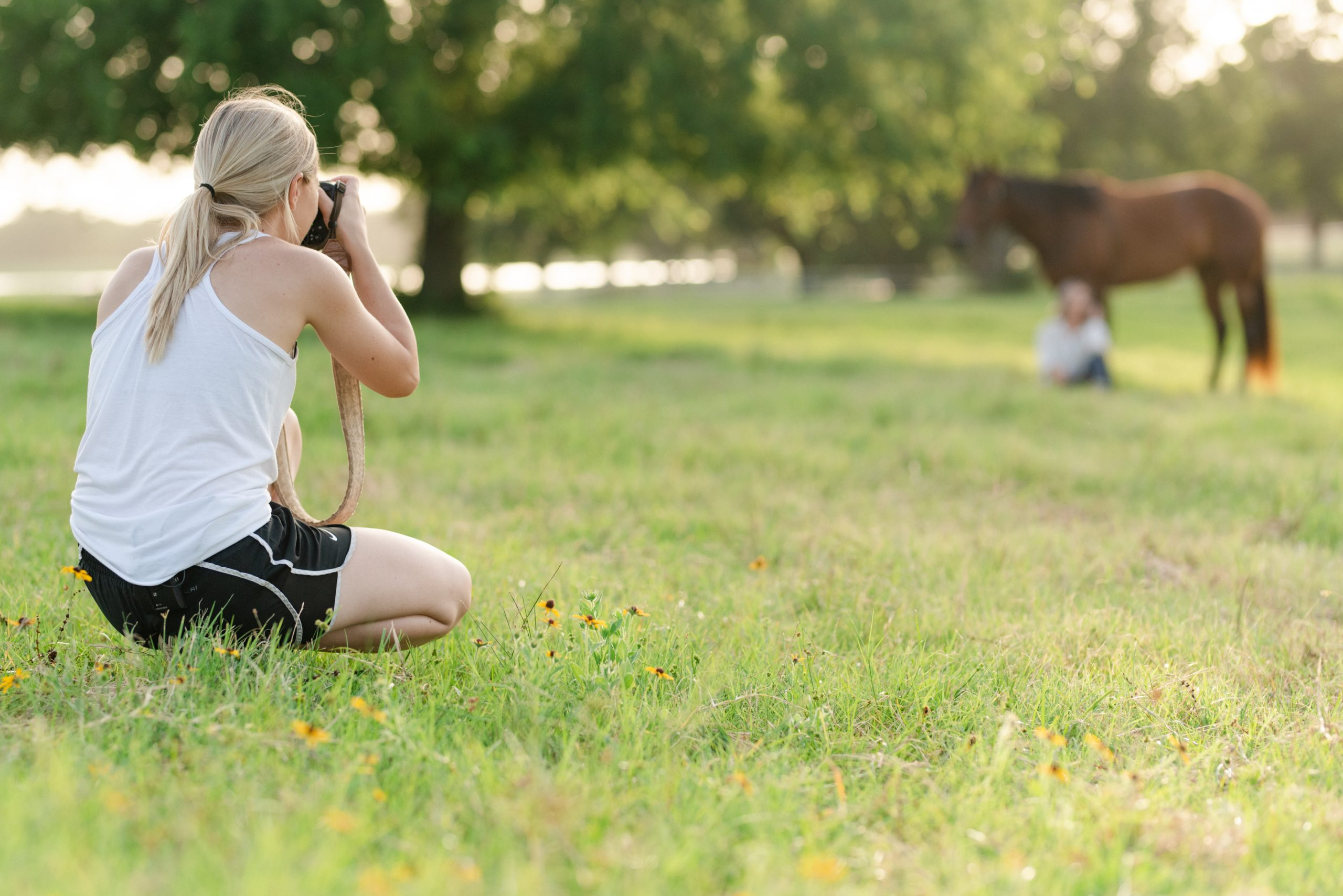 Video of KMP photographing outside with a young girl and horse